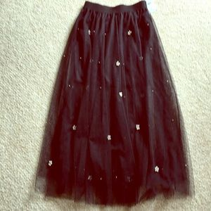 Dresses & Skirts - Black mesh skirt with pearl accent